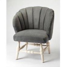 The perfect design statement, this accent chair provides a unique curved back, accented by channeled stitching, while round turned legs in a painted white finish complete the look. The attractive upholstery is soft, velvet-like, sturdy polyester. Its gray