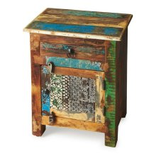 An irresistible combinatinon of rustic charm, vibrant color and intriguing hand-painted design on the door front ensure this piece stands out as original art with benefits -- substantial storage space inside the drawer and behind the door. Crafted from re
