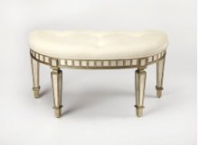 This dynamic mirrored bench brings back the heyday of Hollywood glamour with its curvy half-moon shape and softly tufted ivory cotton seat. The subtle contrast of antiqued mirror tiles and pewter finished wood frame is alluring. Ideal in an entryway or be