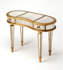 This glamourous and curvy vanity with mirrored top, front and sides in a complementary gold trim, square tapered legs, makes a strong style statement while providing ample storage. It includes two drawers, plus a storage compartment beneath the hinged cen