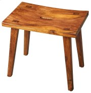 The gently concave seat and zen-like slanted legs of this stool create the irresistible allure of elegant simplicity. The unadulterated wet sand finish showcases the intricate graining of the exotic acacia wood it is crafted from. Product Image