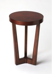 This uncomplicated modern accent table is a great finishing touch in any space. Its three legs taper and conjoin to circular center base. Crafted from rubberwood solids and wood products, it features a book-matched cherry veneer top and a rich Plantation