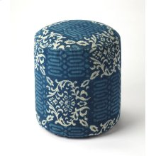 Simple and unpretentious, this stylish transitional pouffe is perfect for resting your feet or for extra seating in the living room, den or bedroom. With a cotton upholstered outer shell over mango wood solids and wood products, its print fabric features