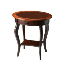 Made of select solid woods, wood products and choice veneers. The top features outer edges of end-cut mozambique veneers with a center inset of select cherry veneers. Cherry veneers on lower display shelf. There is a single drawer with antique brass finis