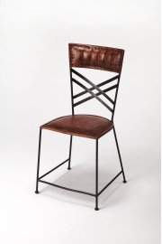 Leather and iron are combined for a rustic industrial aesthetic popular in contemporary design today. Understated with careful leather stitching in warm brown finish and criss-cross iron back panel, this side chair works well alone or in sets! Product Image