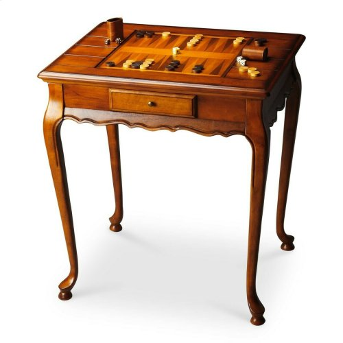 Selected solid woods and choice cherry veneers. Reversible game board inset top, one side chess/checkers and the other backgammon. Drawer with antique brass finished hardware. Chess and other game pieces shown are not included.