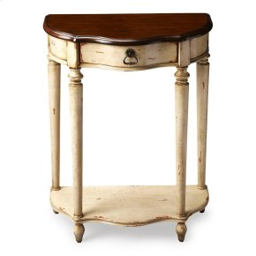 This charming console was designed for small spaces _ perfectly suited for a hall, entryway or stairway landing. Hand painted in a creamy vanilla and crafted from poplar hardwood solids and wood products, it features a rich, contrasting, hand rubbed cherr