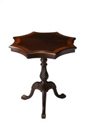 This delightful accent table has a distinctive star burst shaped top and delicately carved pedestal base. Crafted from select hardwood solids, wood products and choice veneers, it features a matched cherry veneer center top inset bordered by dramatic end-