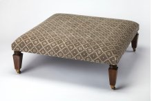 Use this stylish, traditional ottoman as a seat or as a footstool. With its very wide surface area, it can also be used as a makeshift coffee table. Its brown Mango wood solid legs support an unpretentious Urethane foam and cotton fabric seat.