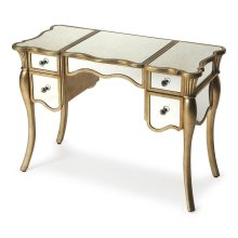 This glamorous vanity is fit for a queen. Its sensuous cabriole legs and curvy top and sides are accentuated by a stunning Silver Leaf painted finish with antiqued mirror veneers. Expertly crafted from poplar hardwood solids and wood products, it boasts f