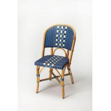 Evoking images of sidewalk tables in the Cote d'Azur, side chairs like this will give your kitchen or patio the casual sophistication of a Mediterranean coastal bistro. Skillfully crafted from thick bent rattan for superb durability, it features weather r
