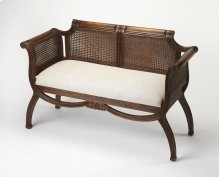 Curl up with favorite novel and a hot cup of tea on this beautiful carved antique bench. Constructed of Rubberwood, wood products and rattan, this bench features a beautiful carved center ribbon motif on the apron, as well as, curved carved legs. The seat