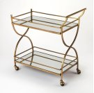 This glamorous modern bart cart is a must-have for anyone that enjoys entertaining. Forged from stainless steel and aluminum, it boasts a mesmerizing antique gold finish with two mirrored glass shelves. Guests will be sure to follow as four large casters Product Image