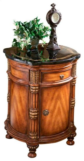Made of select solid woods, wood products, resin components and choice veneers. Fossil stone veneer top with snakeskin fossil stone inlay border. Single drawer and one door with antique brass finished hardware. Center shelf behind door.