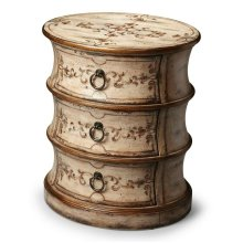 A piece of art that doubles as a versatile and functional three-draw table, this Oval Drum Table adds a touch of class to an already well-furnished room. Our aged Guilded Cream finish serves a perfect canvas for the beautiful hand-painted floral motif on