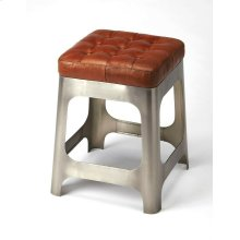At 20 high, this stool great addition to the kitchen, a rustic vanity or seating area. The long Iron legs support a genuine brown leather button tufted seat. Pull up a seat and have a chat!