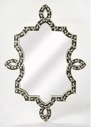 A work of art in any space, this gorgeous wall mirror has a truly unique free form shape with ribbon twists along its sides, top and bottom. Skillfully crafted from resin and wood products, its captivating botanic pattern is formed from hundreds of hand-c Product Image