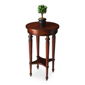 Elegance and versatility make this table a great addition to virtually any space. Featuring a lightly distressed, hand rubbed cherry finish, it is crafted from select hardwood solids and wood products with a lower display shelf and a four-way matched cher