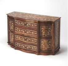 Boasting a rich, distinctive Moroccan bone inlay pattern, this sideboard lends casual elegance to the dining room. Ideal for entertaining, it easily stores serveware and accessories in the assembly of drawers and curved side cabinets, while the top plays
