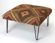 This hip square cocktail ottoman is whimsical and sophisticated. Upholstered in a durable 100% cotton print fabric in hues of cream, gold and black, its iron hairpin legs add a stylish industrial element in the living room. Product Image