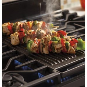 Extra-large, integrated reversible cast iron grill/griddle