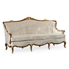 Three seater sofa with gilded carving, upholstered in Calico velvet