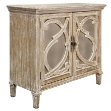 Naples 2 door cabinet features bold overlay grill fronting mirrored doors.