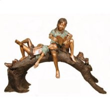 Boy and girl shoes off reading book on log
