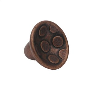Circular-shaped knob with circular inlays made of solid brass. Product Image