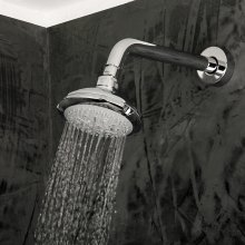 Wall-mount tilting round shower head, four jets. Arm and flange sold separately