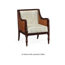 Bergere chair with brown rattan matte sides and back, upholstered in COM