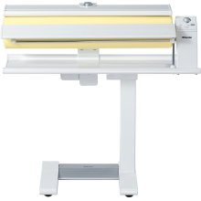 B 990 Rotary ironer with high pressure and a wide heater plate for best results.