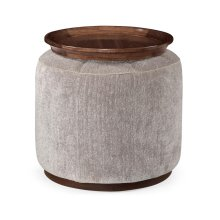 Circular ottoman upholstered in COM