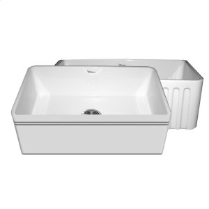 """Farmhaus Fireclay Reversible Series fireclay sink with a decorative 2 1/2"""" lip on one side, a fluted front apron on the opposite side, and a 3 1/2"""" center drain. Product Image"""