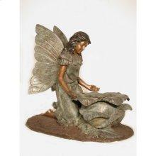 Angel kneeling by planter
