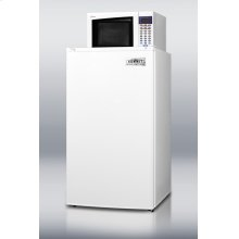 Compact refrigerator-freezer-microwave combination unit with automatic defrost