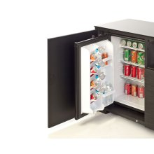 The Salamander refrigerator is built into a cabinet bay and hidden to create a first class refreshment center. 2.5 Cubic feet capacity.