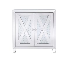 Provide an extraordinary sense of illumination with this ultra-modern side table. With its gleaming mirror covered surfaces, vibrant floating- clear crystal inlaid and criss-cross mirror overlay, your favorite lamp or display will shine in all of its glory sitting upon this two door accent table.