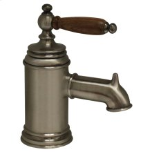 Fountainhaus single-hole, single-lever lavatory faucet with cherry wood handle and pop-up waste.
