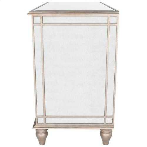 This glamorous console chest features elegant antique mirror inlays on its top, drawer fronts and sides. No detail is overlooked with a beveled edged top and striking pewter finished trim. Handcrafted from select hardwood solids and wood products with ant