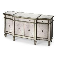 Plenty of storage! Trimmed in antique pewter and crafted from Birch Wood solids, this stunning mirrored buffet is sure to get attention!