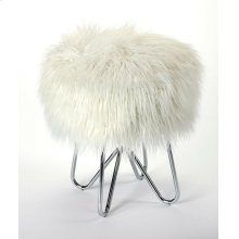 Tastefully textured and fashion forward, this faux fur stool is sure to make a statement in any space. Founded atop a hair pin leg, metal base finished in silver, this piece features a round seat that's covered in faux fur upholstery for a hint of plus