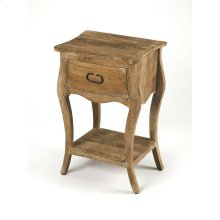 Crafted from mango wood solids and wood products in a natural mango finish, this nightstand is perfect for stowing bedside essentials. This lovely nightstand showcases a single drawer with iron hardware, a scalloped apron and lower display shelf.