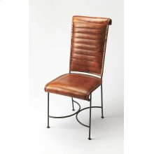 This verstile chair with its graceful curves, gentle tapering and the hand crafted artistry of forged wrought iron, combines with the rugged natural beauty of top stitched leather seat and back. This modern chair is perfect in any modern or transitional d