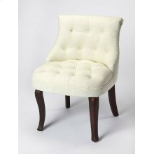 Round out a refined seating group with this slipper chair, or top it with a bright pillow to make a splash in a bolder space. With its rolled back, button tufting, and brown flirty legs, this armless slipper chair is sure to be the central focus of your