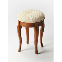 This splendid vanity stool adds formal elegance to any powder or dressing room. Handcrafted from hardwood solids and veneers, it features impeccably carved and tapered legs, ballerina feet, Olive Ash Burl finish and a comfortable seat upholstered in cotto