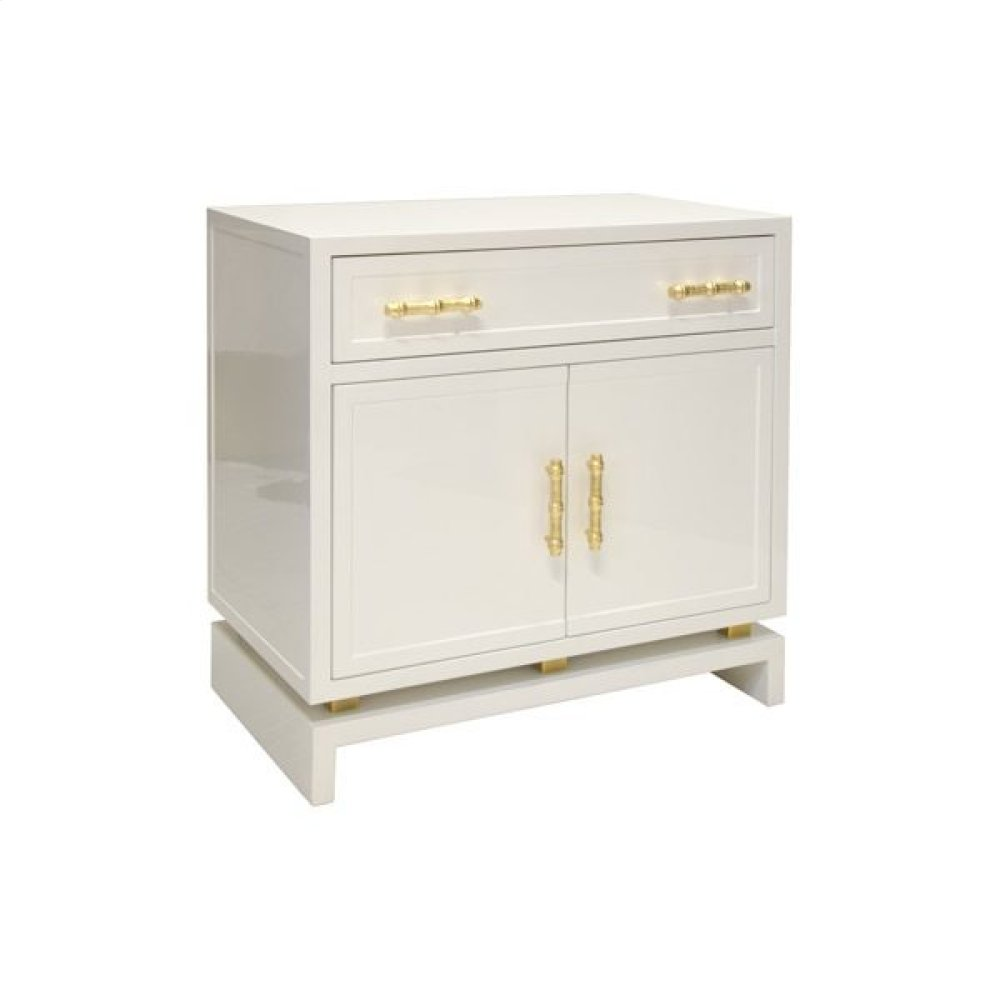 White Lacquer (1) Drawer- 2 Door Nightstand With Gold Leafed Bamboo Hardware and Gold Leaf Metal Detail On Base. Drawer On Glides- Interior Features 1 Non Adjustable Shelf.