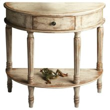 Add style and elegance to your home with this demilune console. Features oak veneers with an artisan-applied crackled, distressed Chateau Gray paint finish. Crafted from poplar hardwood solids, wood products and choice cherry veneers with antique brass fi