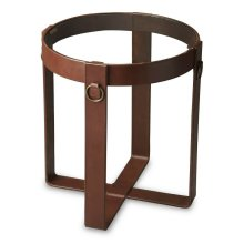 This lamp table epitomizes subtle elegance. Forged from steel with a tempered clear glass top, it features a chestnut leather-wrapped frame and antique brass rings for an intriguing aesthetic.