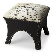 This handsome ottoman is rustic yet transitional in style. Brass finished nail heads outline the polyester suede base, providing contrast to the genuine cowhide cushioned seat. This piece can be used individually or in multiples. Note, the cowhide may var